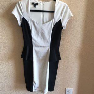 Black and white peplum dress